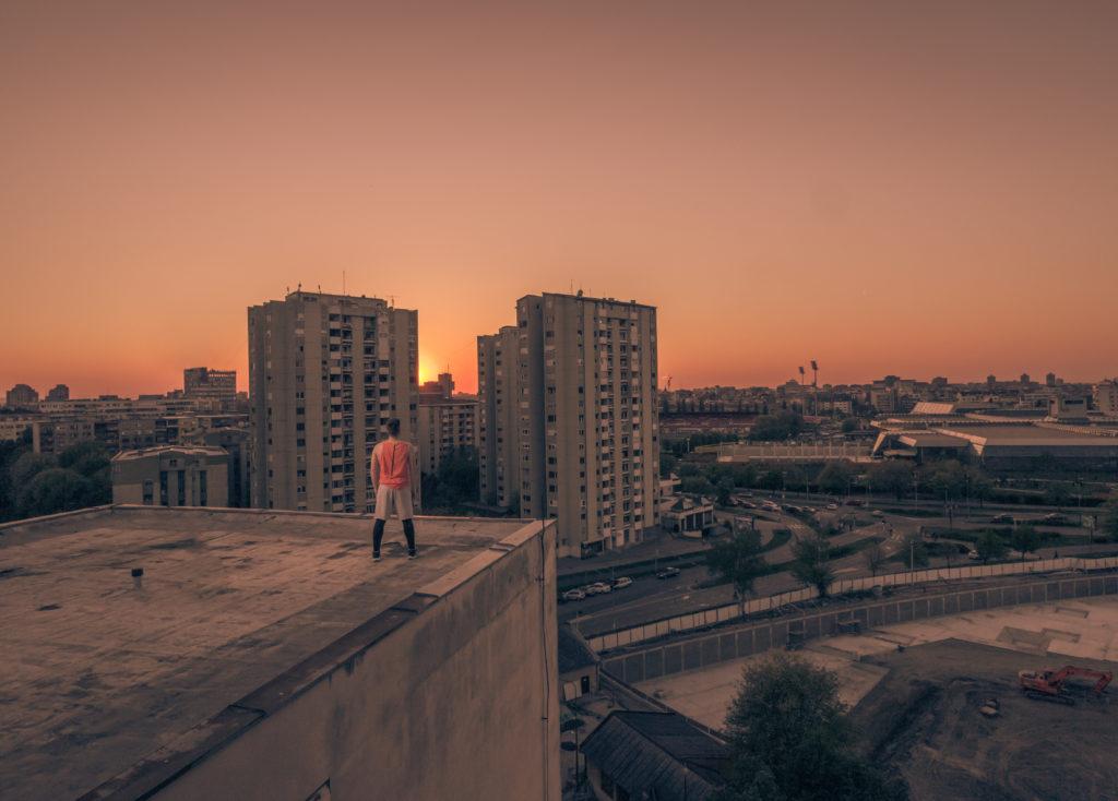 Man Standing Roof Rooftop Buildings City Urbanscene Sun